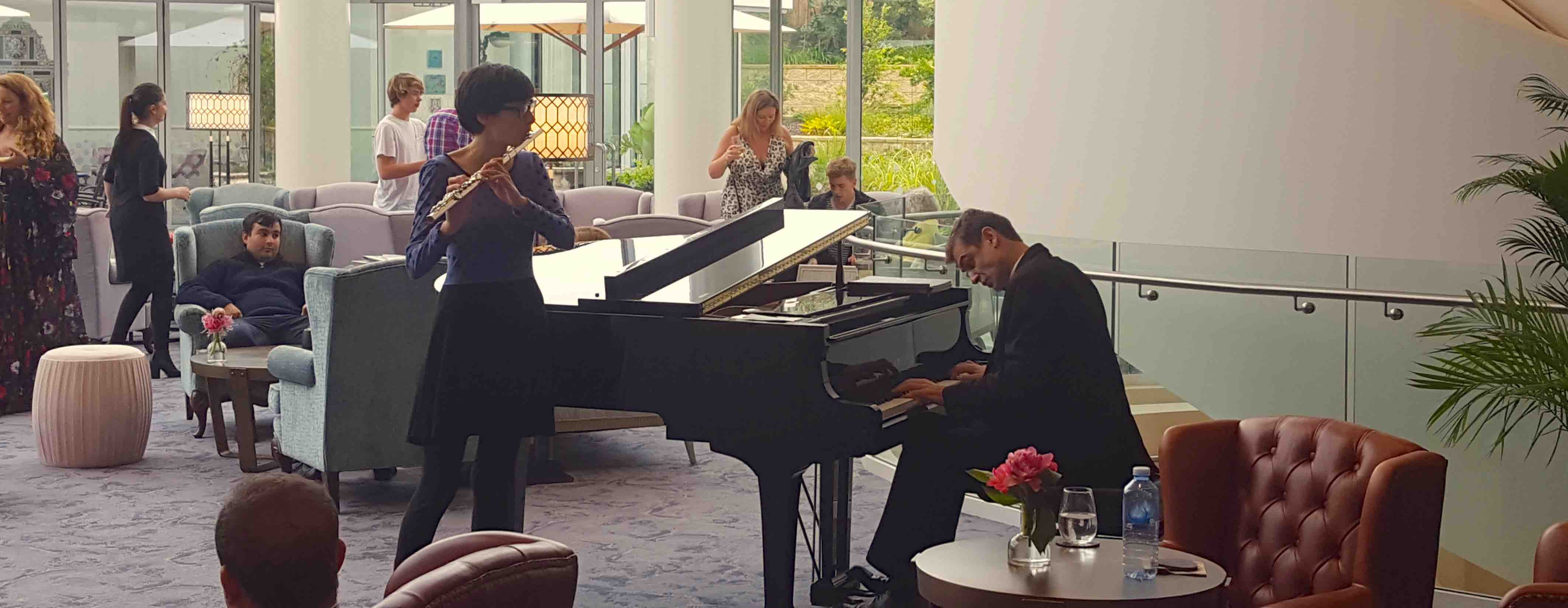 patrick plays grand piano at westfield VIP function